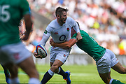 England player Elliot Daly looks to offload the ball in the first half during the England vs Ireland warm up fixture at Twickenham, Richmond, United Kingdom on 24 August 2019.