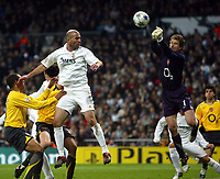 Photo: Chris Ratcliffe.<br />Real Madrid v Arsenal. UEFA Champions League. 2nd Round, 1st Leg. 21/02/2006.<br />Zinedine Zidane of Real Madrid is beaten to the ball by Jens Lehmann of Arsenal.
