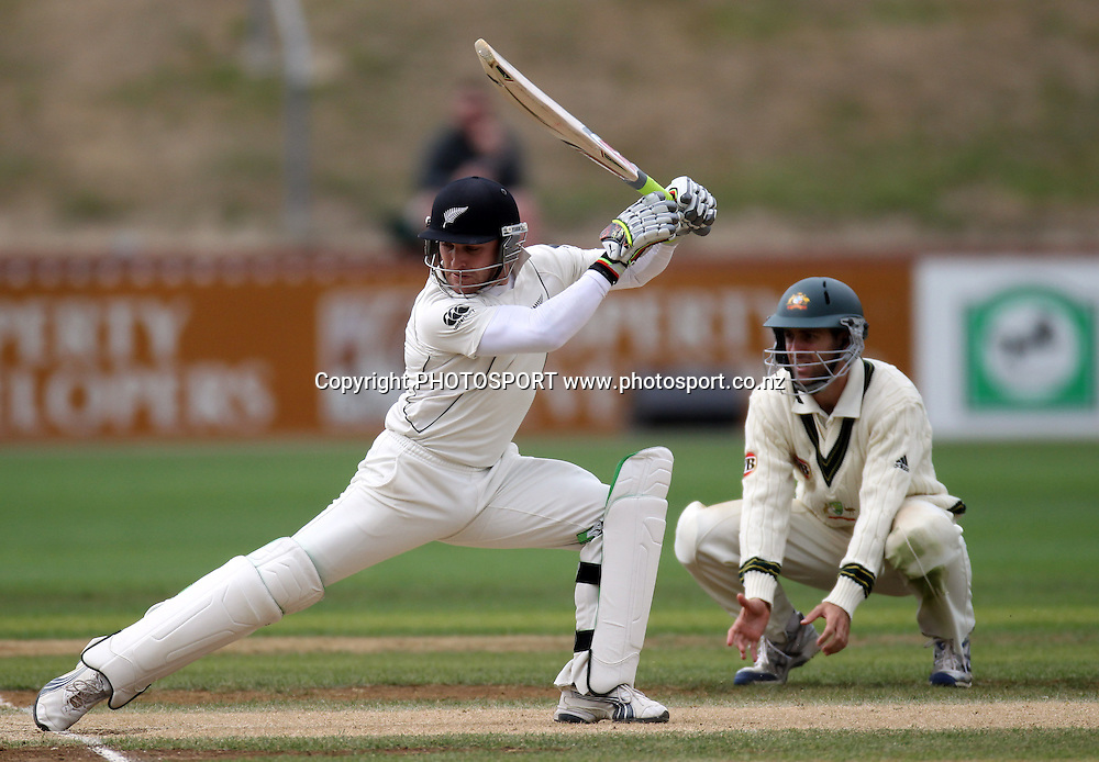 New Zealand batsman Brendon McCullum stretches back into the crease  as Simon Katich looks on.<br />