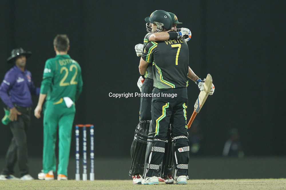 Michael Hussey and Cameron White celebrate the win during the ICC World Twenty20 Super 8s match between Australia and South Africa held at the Premadasa Stadium in Colombo, Sri Lanka on the 30th September 2012<br /> <br /> Photo by Ron Gaunt/SPORTZPICS