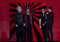 U2 on stage collecting the Global Icon award during the MTV Europe Music Awards 2017 held at The SSE Arena, London. Photo credit should read: Doug Peters/EMPICS Entertainment