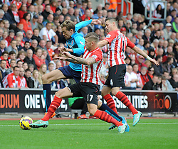 Stoke's Peter Crouch is challenged by Southampton's Saphir Taider - Photo mandatory by-line: Dougie Allward/JMP - Mobile: 07966 386802 - 25/10/2014 - SPORT - Football - Southampton - ST Mary's Stadium - Southampton v Stoke - Barclays Premier League