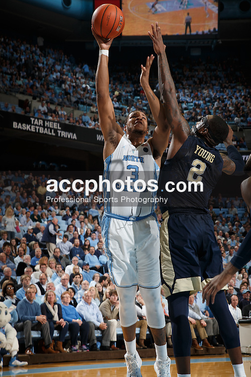 CHAPEL HILL, NC - JANUARY 31: Kennedy Meeks #3 of the North Carolina Tar Heels shoots over Michael Young #2 of the Pittsburgh Panthers on January 31, 2017 at the Dean Smith Center in Chapel Hill, North Carolina. North Carolina won 80-78. (Photo by Peyton Williams/UNC/Getty Images) *** Local Caption *** Kennedy Meeks;Michael Young