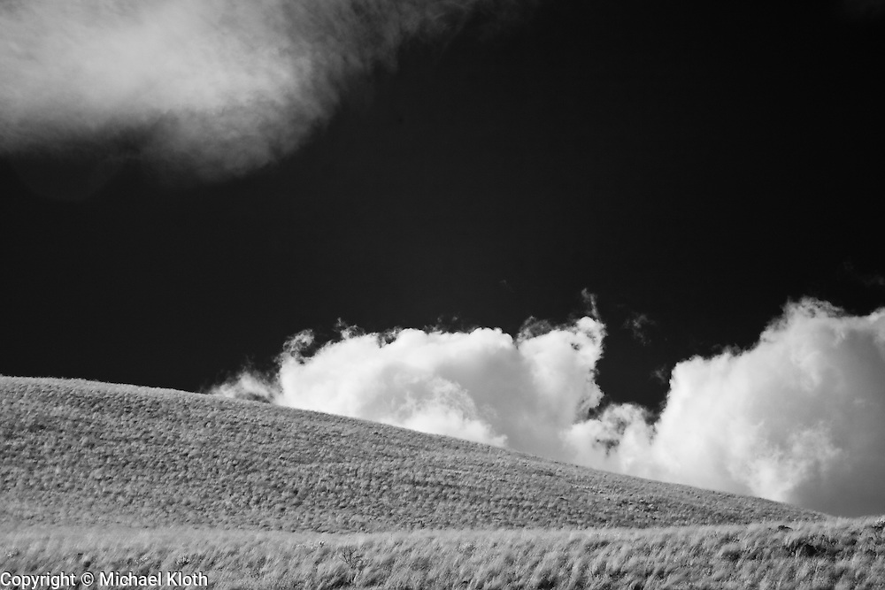 Infrared (IR) image - Eastern Washington high desert landscape.  The clouds, black sky, and white desert scrub give this image an other worldly look.
