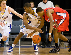 February 27, 2010; San Jose, CA, USA;  San Jose State Spartans center Chris Oakes (30) and Fresno State Bulldogs guard/forward Paul George (24) battle for a loose ball during the first half at The Event Center.  San Jose State defeated Fresno State 72-45.