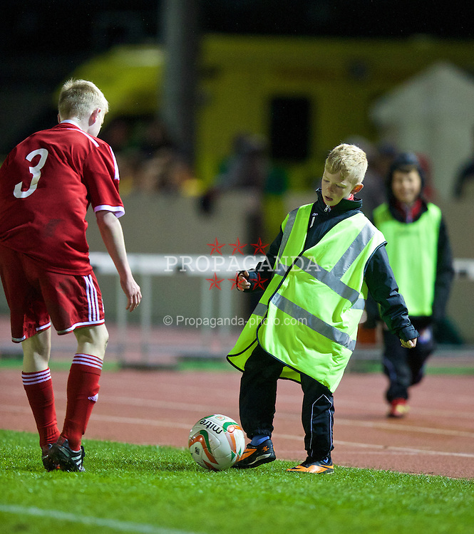 CONNAH'S QUAY, WALES - Thursday, March 20, 2014: A ball-boy during the Under-15's International Friendly match between Wales and Poland at the Deeside Stadium. (Pic by David Rawcliffe/Propaganda)