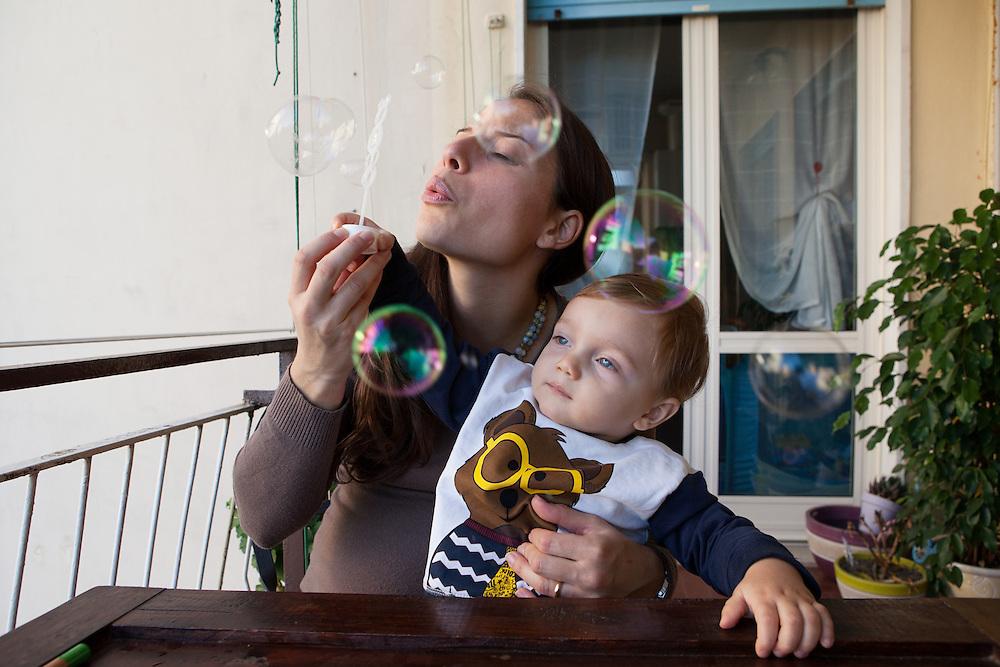 Federica and Giulio - Naples, October 2015. Federica, 30 years old, with her first son Eugenio, one year old, in the images is eight months pregnant of her second child, a girl.<br />Federica has been aware to be affected by multiple sclerosis from 2012. Despite the difficulties, she did not allow the disease to compromise her happiness and the desire to be a mother.<br /><br />Federica e Giulio - Napoli, Ottobre 2015.&nbsp;Federica, 30 anni, con il figlio Eugenio, un anno, nelle immagini &egrave; in attesa all'ottavo mese della secondogenita Eleonora.<br /> Federica ha saputo di essere affetta da sclerosi multipla nel 2012. Nonostante le difficolt&agrave; non ha permesso che la patologia compromettesse la sua felicit&agrave; e desiderio di essere madre.