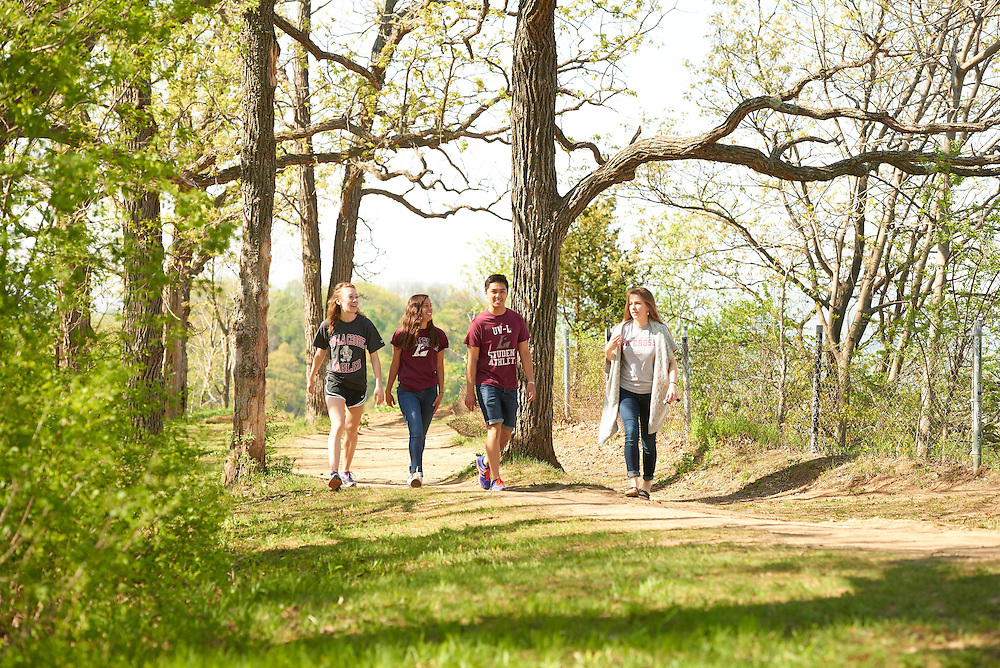 Activity; Smiling; Socializing; Walking; Buildings; Bluffs; Grandad Bluff; Location; Outside; People; Student Students; Woman Women; Man Men; Spring; May; Time/Weather; day; sunny; Type of Photography; Lifestyle; UWL UW-L UW-La Crosse University of Wisconsin-La Crosse; Candid