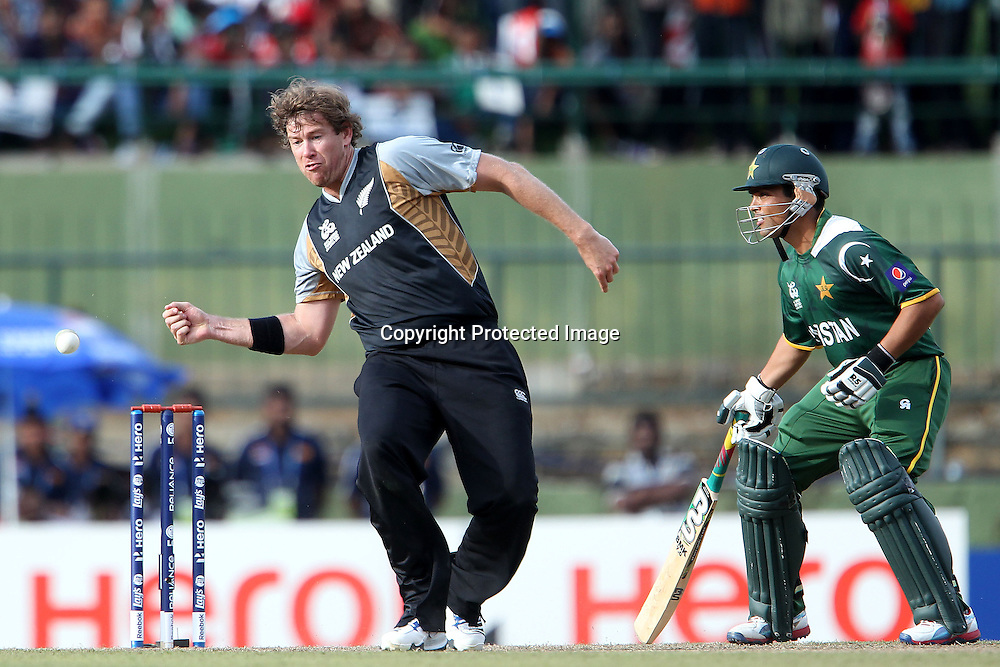 Jacob Oram fields from his own bowling during the ICC World Twenty20 Pool match between Pakistan and New Zealand held at the  Pallekele Stadium in Kandy, Sri Lanka on the 23rd September 2012<br /> <br /> Photo by Ron Gaunt/SPORTZPICS/PHOTOSPORT