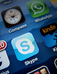 Close-up of screen of iPhone 4G smart phone showing Skype app