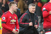Manchester United interim Manager Ole Gunnar Solskjaer celebrates with Manchester United Defender Luke Shaw after victory during the Premier League match between Fulham and Manchester United at Craven Cottage, London, England on 9 February 2019.