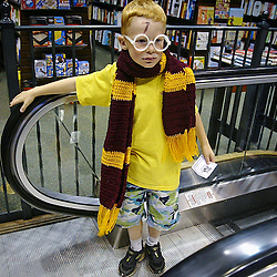 Timothy Petersen, 7, of Lake City rides up the elevator looking for trivia questions at a Harry Potter party at Barnes and Noble Friday July 20, 2007. Petersen resembles a minature Ron for the book series his mother Starr said.   (Christina Paolucci, Post-Bulletin)