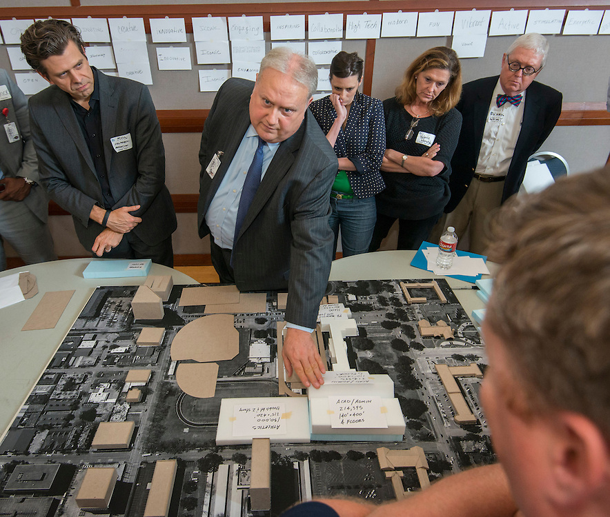 Lamar High School principal James McSwain, center, Project Advisory Team and Perkins Will architects discuss concepts during a design charrette at Rice University, May 12, 2014.