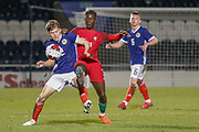 Cameron Logan (Heat of Midlothian) tackles Gerson during the U17 European Championships match between Portugal and Scotland at Simple Digital Arena, Paisley, Scotland on 20 March 2019.