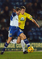 Photo: Paul Greenwood.<br />Bury v Hereford United. Coca Cola League 2. 30/01/2007. Bury's Glyn Hurst, left, shields the ball from Phil Gulliver