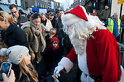 FATHER CHRISTMAS, Belgravia Christmas Sunday. Elizabeth Street, Motcomb Street and Pimlico Rd. various Christmas activities. Father Christmas will also visited each street on his sleigh pulled by his reindeer. London. 6 December 2009<br />  <br />  *** Local Caption *** -DO NOT ARCHIVE-© Copyright Photograph by Dafydd Jones. 248 Clapham Rd. London SW9 0PZ. Tel 0207 820 0771. www.dafjones.com.<br /> FATHER CHRISTMAS, Belgravia Christmas Sunday. Elizabeth Street, Motcomb Street and Pimlico Rd. various Christmas activities. Father Christmas will also visited each street on his sleigh pulled by his reindeer. London. 6 December 2009