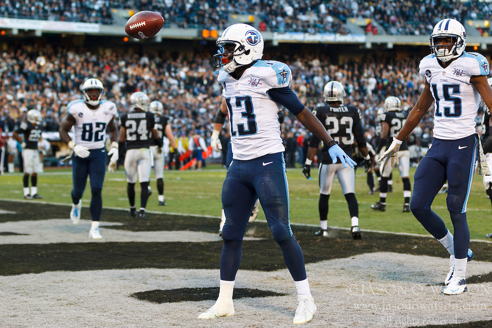 OAKLAND, CA - NOVEMBER 24: Kendall Wright #13 of the Tennessee Titans celebrates after scoring the game winning touchdown against the Oakland Raiders during the fourth quarter at O.co Coliseum on November 24, 2013 in Oakland, California. The Tennessee Titans defeated the Oakland Raiders 23-19. (Photo by Jason O. Watson/Getty Images) *** Local Caption *** Kendall Wright