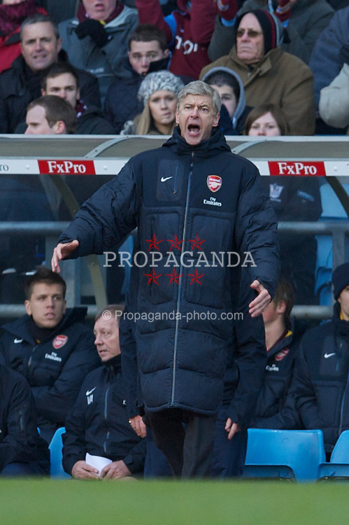 BIRMINGHAM, ENGLAND - Saturday, November 27, 2010: Arsenal's manager Arsene Wenger leaps out of his seat to appeal a decision during the Premiership match against Aston Villa at Villa Park. (Pic by: David Rawcliffe/Propaganda)