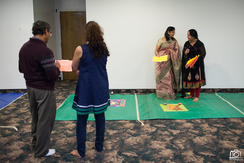 From left to right, Ashvin Panchal of Fremont, an unidentified witness, Krishna Shah of Sunnyvale, and Neha Shah of Santa Clara judge the Diwali Rangoli competition at the Shreemaya Krishnadham Temple in Milpitas, California, on November 2, 2013. (Stan Olszewski/SOSKIphoto)