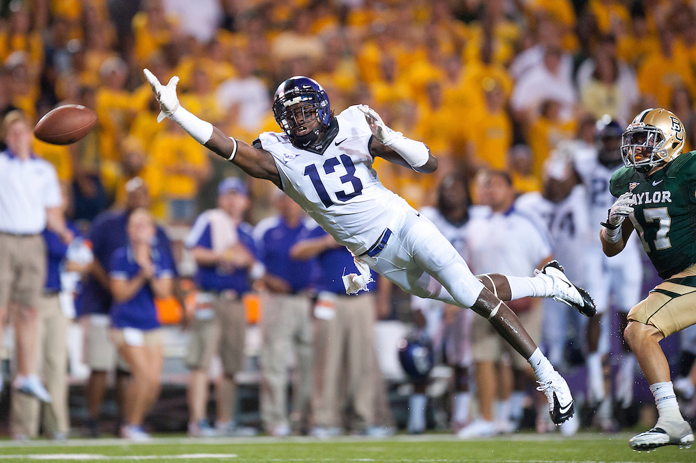 WACO, TX - SEPTEMBER 02: Antoine Hicks #13 of the TCU Horned Frogs attempts to make a diving catch during the game against the Baylor Bears at Floyd Casey Stadium on September 02, 2011 in Waco, Texas. ( Photo by: Rob Tringali) *** Local Caption *** Antoine Hicks