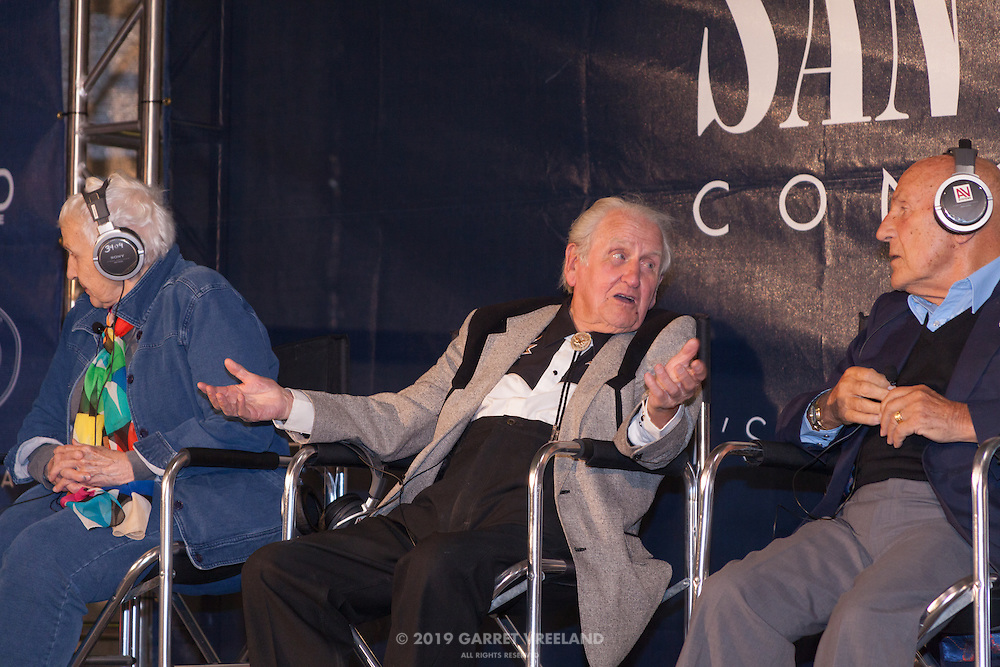 Denise McCluggage, Norman Dewis and Sir Stirling Moss during Legends of Racing interview, Planes and Cars at the Santa Fe Airport, 2013 Santa Fe Concorso.