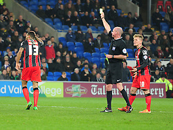 Bournemouth's Callum Wilson gets booked for blocking Cardiff City's Simon Moore goal kick. - Photo mandatory by-line: Alex James/JMP - Mobile: 07966 386802 - 17/03/2015 - SPORT - Football - Cardiff - Cardiff City Stadium - Cardiff City v AFC Bournemouth - Sky Bet Championship