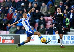 Harrison McGahey of Rochdale takes on James Vaughan of Wigan Athletic - Mandatory by-line: Robbie Stephenson/JMP - 24/02/2018 - FOOTBALL - DW Stadium - Wigan, England - Wigan Athletic v Rochdale - Sky Bet League One