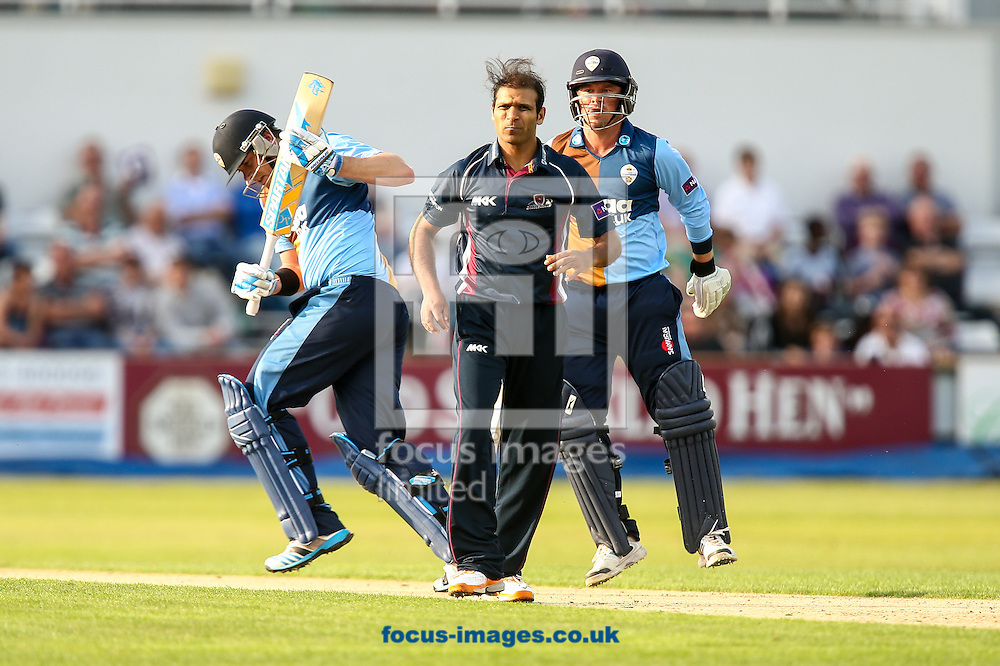 Muhammad Azhar Ullah of Northants Steelbacks (centre) looks for the ball as the batsmen run during the Natwest T20 Blast match at the County Ground, Northampton<br /> Picture by Andy Kearns/Focus Images Ltd 0781 864 4264<br /> 11/07/2014