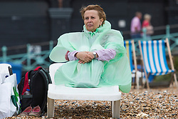 © Licensed to London News Pictures. 22/07/2017. Brighton, UK. Members of the public brave the colder and grey temperatures to take some time out on the beach in Brighton and Hove. Photo credit: Hugo Michiels/LNP