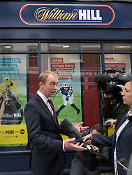 © Licensed to London News Pictures. 07/06/2017. Twickenham, UK. Liberal Democrat leader Tim Farron gives an interview in front of a betting shop as he campaigns in Twickenham with local candidate Vince Cable on the last day of the election before the polls open. Photo credit: Peter Macdiarmid/LNP
