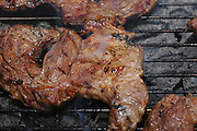 meat cooking on the barbecue;
