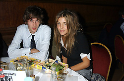ISAAC FERRY and SCARLETT STRUTT at a quiz night in aid of RAPt ( The Rehabilitation for Addicted Prisoners Trust) held at Hammersmith Town Hall, King Street, London W6 on 14th November 2005.<br />