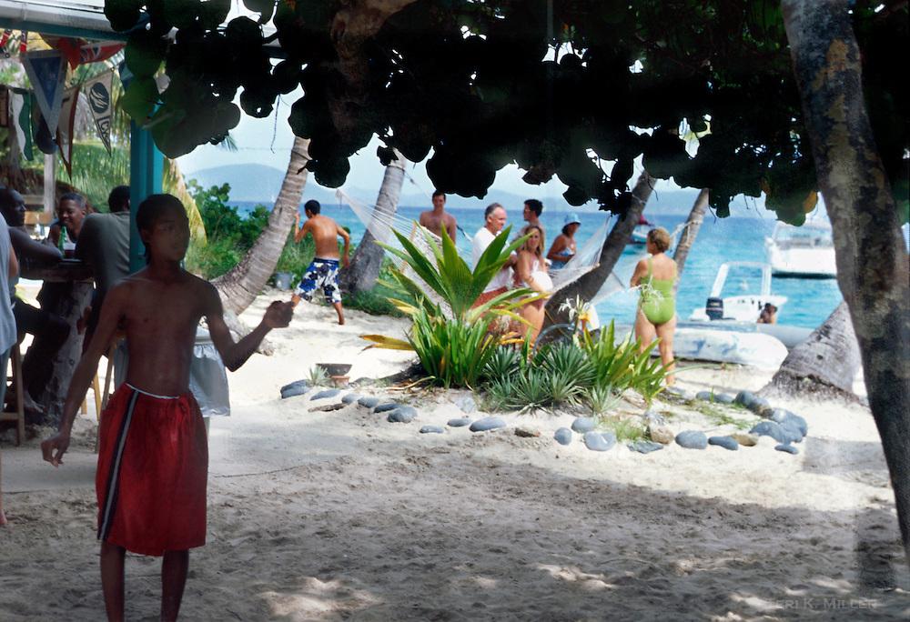 A boy plays the ring game at the Soggy Dollar Bar at Sandcastle Resort, Jost Van Dyke, British Virgin Islands.