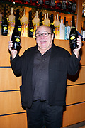 NEW YORK - NOVEMBER 6:  Danny Devito mixes Limoncello drinks At The New York Marriot Marquis November 6, 2007 in New York City (Photo by Matt Peyton)