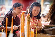 02 MARCH 2008 -- BANGKOK, THAILAND:   Women pray in the Kuan Yim Shrine in the Chinatown section of Bangkok, Thailand. The shrine was established by the Than Ya Foundation which established the first medical clinic for the city's poor and immigrant families in Bangkok. There is still a hospital attached to the shrine.    Photo by Jack Kurtz/ZUMA Press