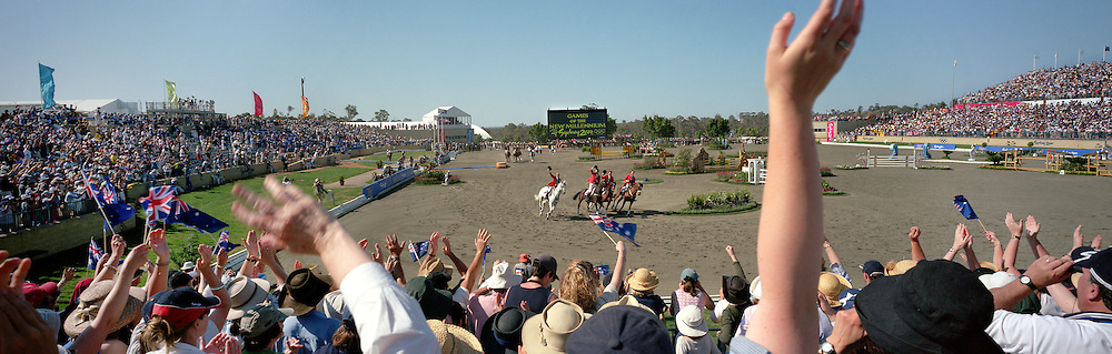 A panoramic image showing the Australian Eventing team of Phillip Dutton on House Doctor, Andrew Hoy on Darien Powers, Stuart Tinney  on Jeepster and Matt Ryan on Kibah Sandstone celebrating their Gold Medal win during the Equestrian competition at the Sydney Equestrian Centre during the  2000 Sydney Olympic Games...Panoramic images from the Sydney Olympic Games, Sydney, Australia.  2000 . Photo Tim Clayton