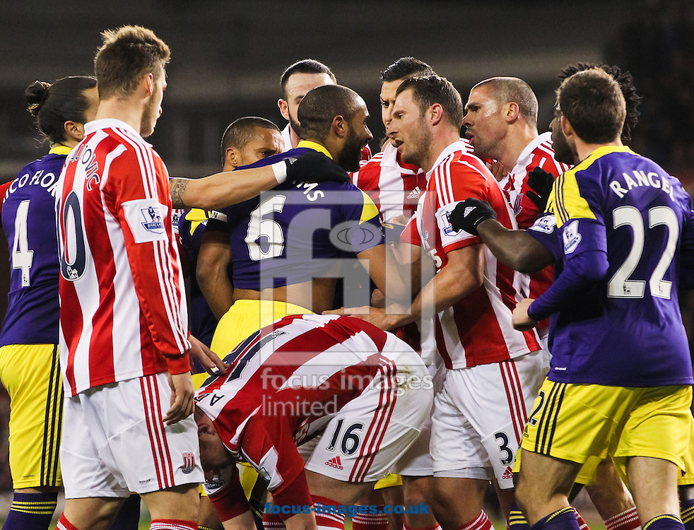 Ashley Williams (centre) of Swansea City argues with Stoke City players during the Barclays Premier League match at the Britannia Stadium, Stoke-on-Trent<br /> Picture by Tom Smith/Focus Images Ltd 07545141164<br /> 12/02/2014