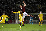 Northampton Town defender David Buchanan jumps for the ball during the The FA Cup match between Northampton Town and Milton Keynes Dons at Sixfields Stadium, Northampton, England on 9 January 2016. Photo by Dennis Goodwin.
