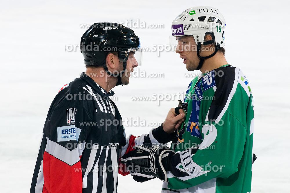 Ziga Pance (HDD Tilia Olimpija, #19) talking to referee Thomas Berneker during ice-hockey match between HDD Tilia Olimpija and EC KAC in 32nd Round of EBEL league, on December 28, 2010 at Hala Tivoli, Ljubljana, Slovenia. (Photo By Matic Klansek Velej / Sportida.com)