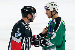 Ziga Pance (HDD Tilia Olimpija, #19) talking to referee Thomas Berneker during ice-hockey match between HDD Tilia Olimpija and EC KAC in 32nd Round of EBEL league, on December 28, 2010 at Hala Tivoli, Ljubljana, Slovenia. (Photo By Matic Klansek Velej / Sportida.com)