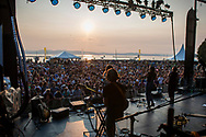The sun sets over Lake Champlain during the set by the band Joseph during day 2 of the Grand Point North music festival at Waterfront Park on Sunday afternoon September 17, 2017 in Burlington. (BRIAN JENKINS/for the FREE PRESS)