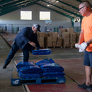 OCTOBER 20 - PONCE, PUERTO RICO - <br /> Donated tarps, water and MRE's in a distribution center in a sports arena in the Southern town of Ponce, the 2nd largest city in Puerto Rico. <br /> (Photo by Angel Valentin/Freelance)