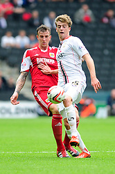 Bristol City's Aden Flint closes down Milton Keynes Dons' Patrick Bamford  - Photo mandatory by-line: Dougie Allward/JMP - Tel: Mobile: 07966 386802 24/08/2013 - SPORT - FOOTBALL - Stadium MK - Milton Keynes -  Milton Keynes Dons V Bristol City - Sky Bet League One