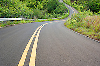 Winding highway 550 on the way up to Waimea Canyon just North of Waimea, Kauai, Hawaii, USA.