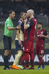 April 9, 2018 - Mexico City, MEXICO CITY, Mexico - Paul Aguilar of Club America discuss with Michael Bradley of Toronto FC during 2018 CONCACAF Champions League Semifinals, Leg 2 match between Club America and Toronto FC at Azteca Stadium in Mexico City, Mexico on 10 April, 2018. (Credit Image: © Ernesto Perez/NurPhoto via ZUMA Press)