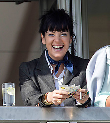 Lily Allen attends the Cheltenham Festival and celebrates backing the winner in the Gold Cup. Cheltenham Racecourse, Cheltenham, United Kingdom. Friday, 14th March 2014. Picture by i-Images