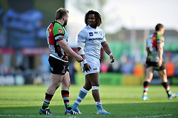 England team-mates Joe Marler (Harlequins) has a word with Marland Yarde (London Irish) as the latter walks off the pitch having received a yellow card - Photo mandatory by-line: Patrick Khachfe/JMP - Tel: Mobile: 07966 386802 29/03/2014 - SPORT - RUGBY UNION - The Twickenham Stoop, London - Harlequins v London Irish - Aviva Premiership.