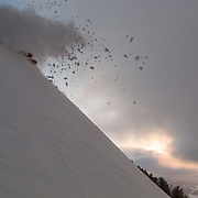Jim Ryan skis powder and gets air at sunrise in the Teton backcountry.