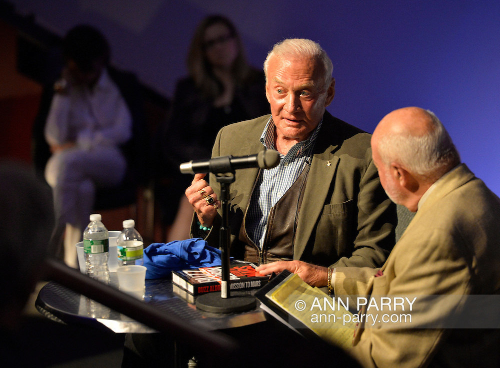 """May 11, 2013 - Garden City, New York U.S. -  Astronaut BUZZ ALDRIN, at center, the second person to walk on the moon, is in conversation with DICK DUNNE, and then signs Aldrin's new books ''Mission to Mars"""" and the illustrated history of space exploration """"Look to the Stars.""""  The lecture in the JetBlue Sky Theater Planetarium by Aldrin, the NASA astronaut engineer of Apollo 11 in 1969, was Sold Out, but people who bought his books at the museum book store could attend the book signing in the LEM room of the Cradle of Aviation Museum."""