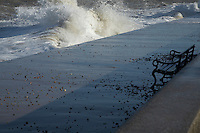 Water crashing on cement pier